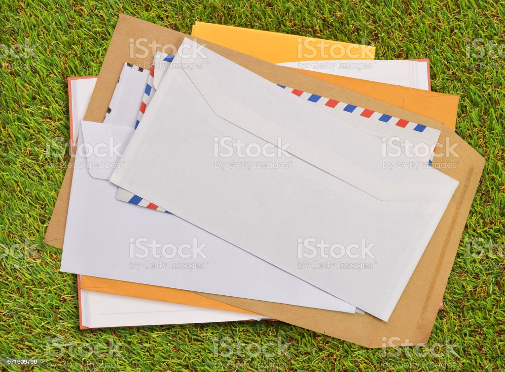 Envelopes on grass stock photo