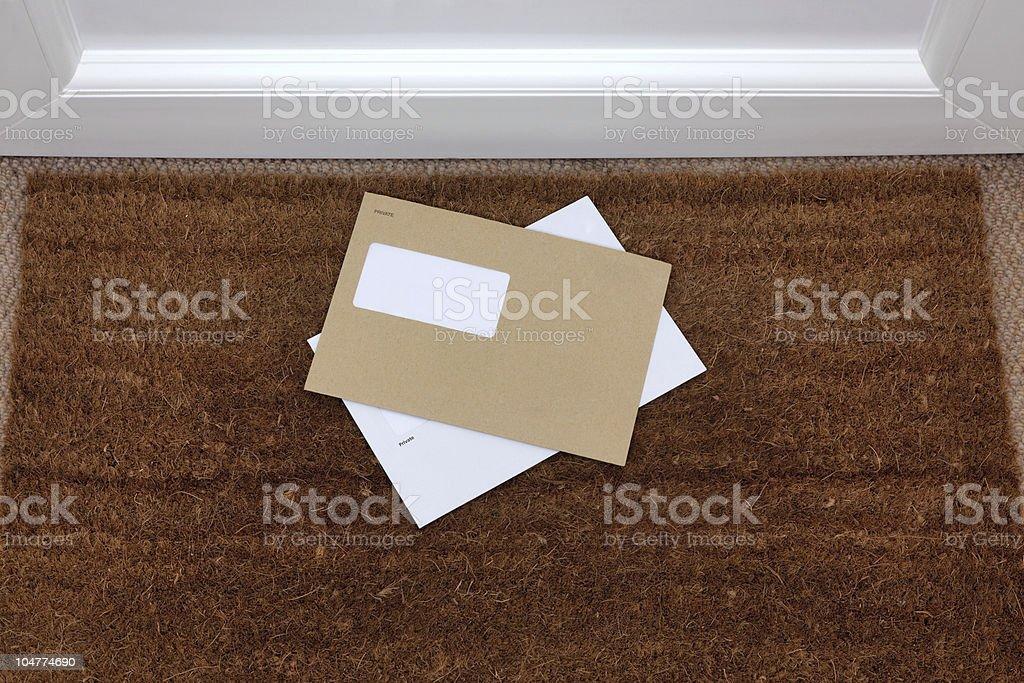 Envelopes on the doormat stock photo