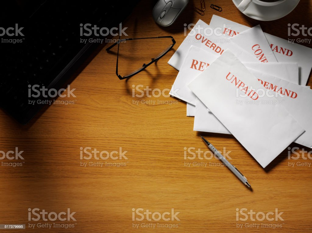 Envelopes with a Computer Keyboard on a Office Desk stock photo