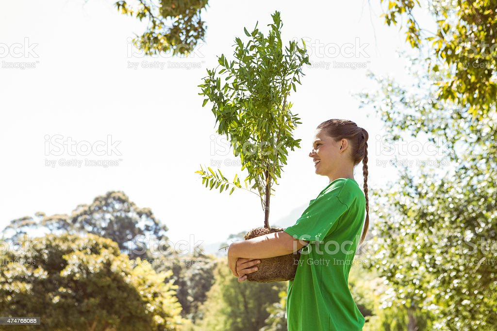 Environmental activist about to plant tree stock photo