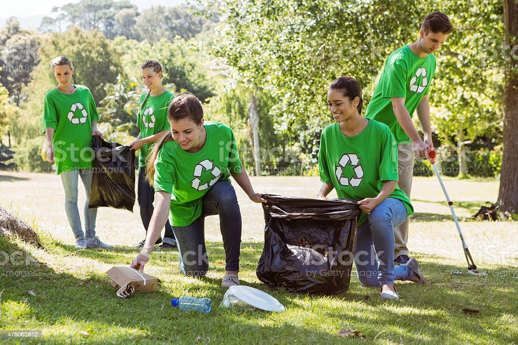 Environmental activists picking up trash stock photo