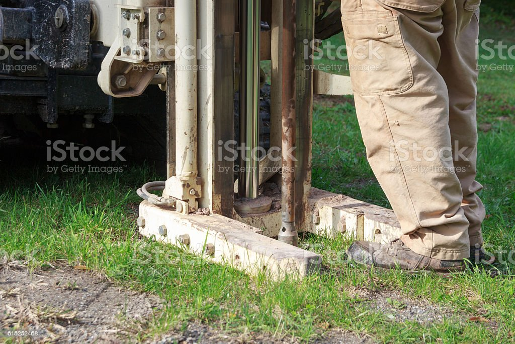 Environmental drilling rig advances soil borings into the ground stock photo