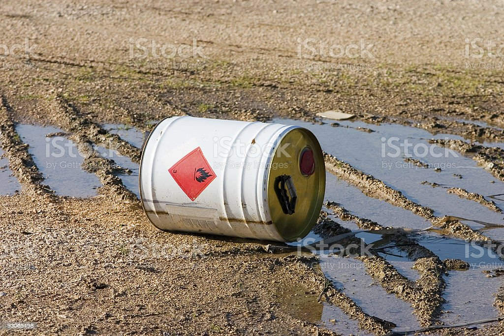 Environmental hazard pouring waste into the dirt royalty-free stock photo