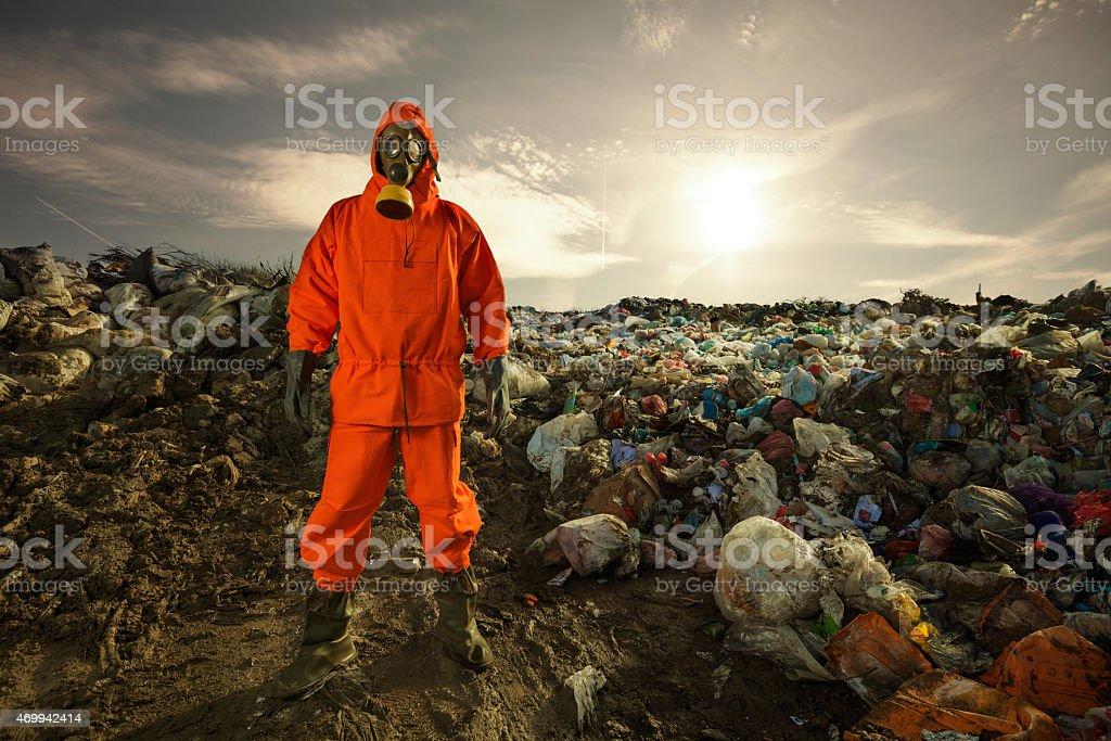Environmental protection worker in an orange hazmat suit stock photo