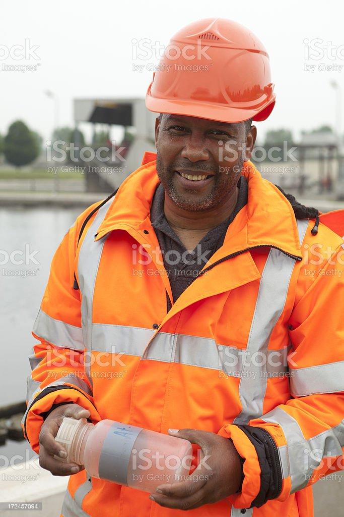 Environmentalist at sewage treatment plant royalty-free stock photo