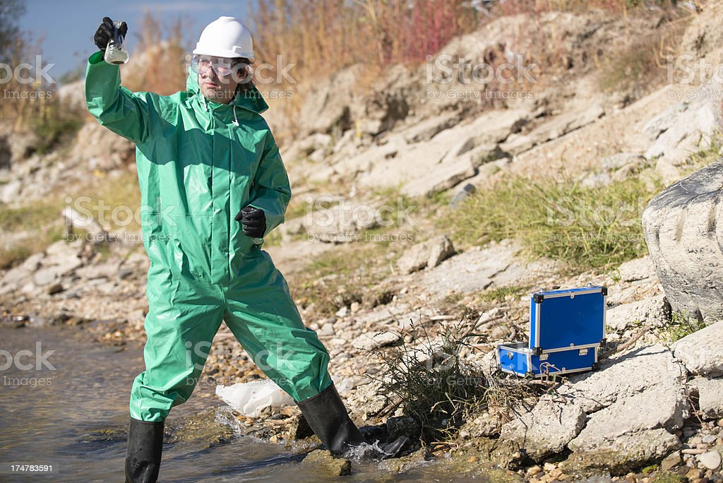 Environmentalist holding sample of polluted water royalty-free stock photo