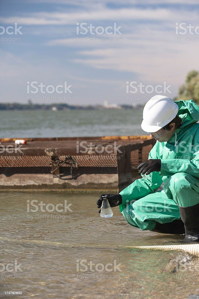 Environmentalist with sample of polluted water royalty-free stock photo