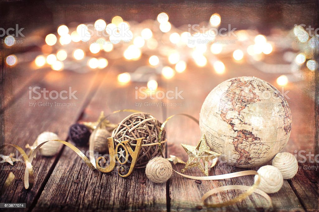 Environmentally Friendly Christmas Decorations and Globe on Old Wood Background stock photo