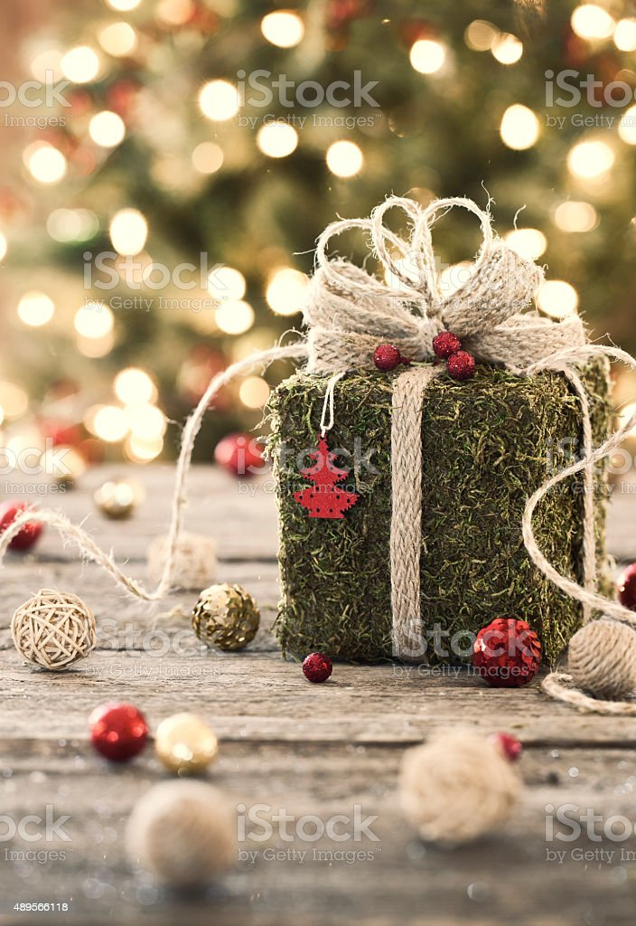 Environmentally Friendly Christmas Gift Wrapped in Moss stock photo