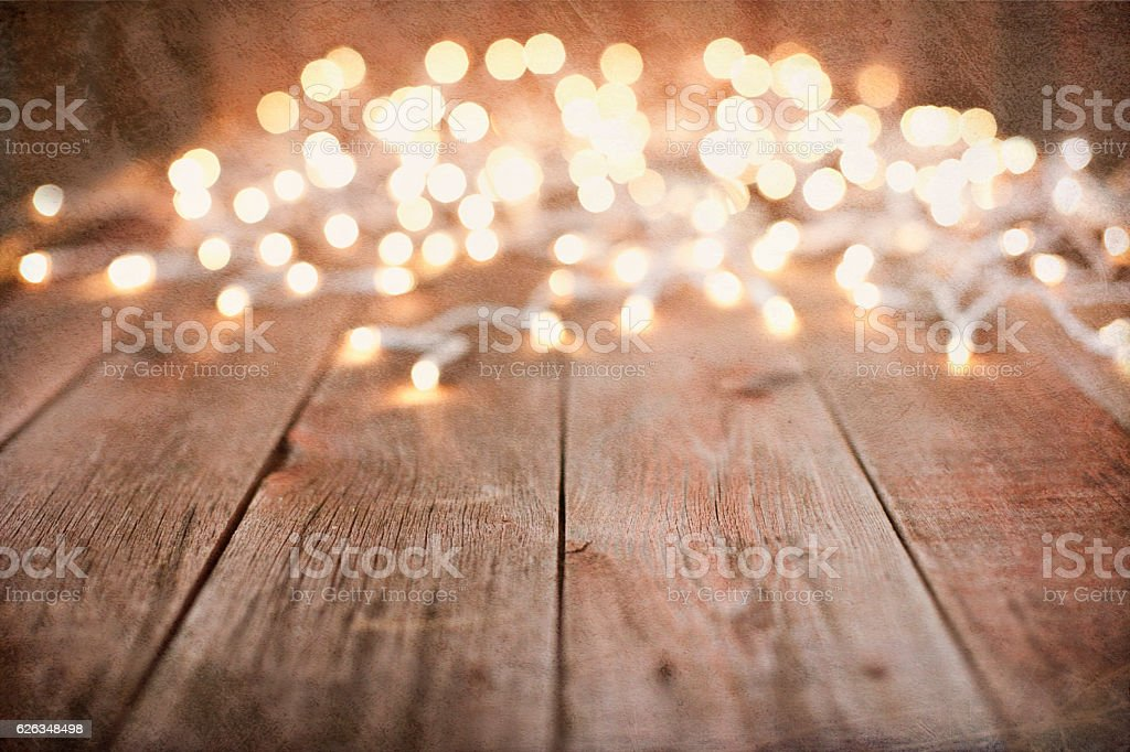 Environmentally Friendly Christmas Lights Old Wood Background stock photo