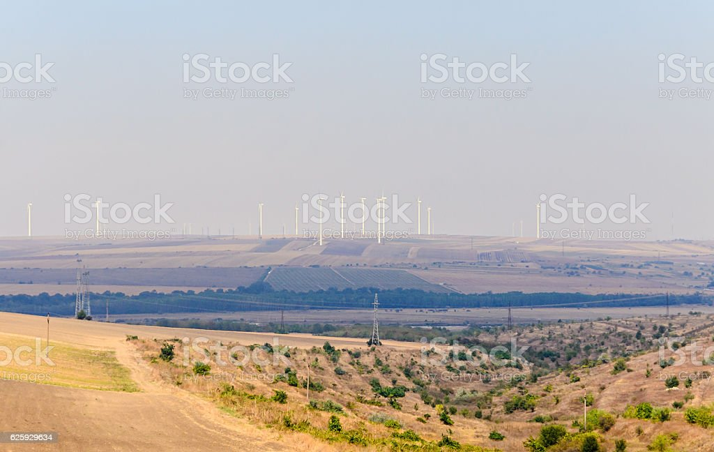 Eolian field and wind turbines farm, countryside stock photo