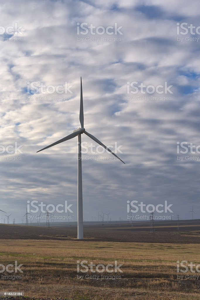 Eolian field and wind turbines farm on a cloudy day stock photo
