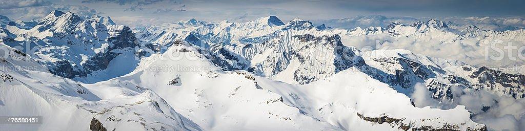 Epic Alpine mountain peaks pinnacles panorama snowy winter summits glaciers stock photo
