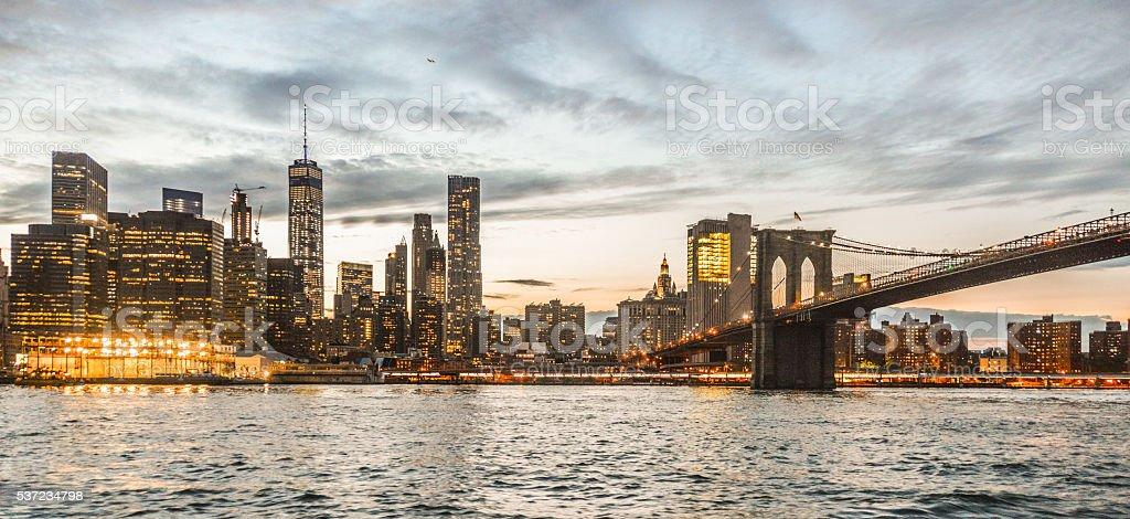 Epic New York City Manhattan skyline during sunset stock photo