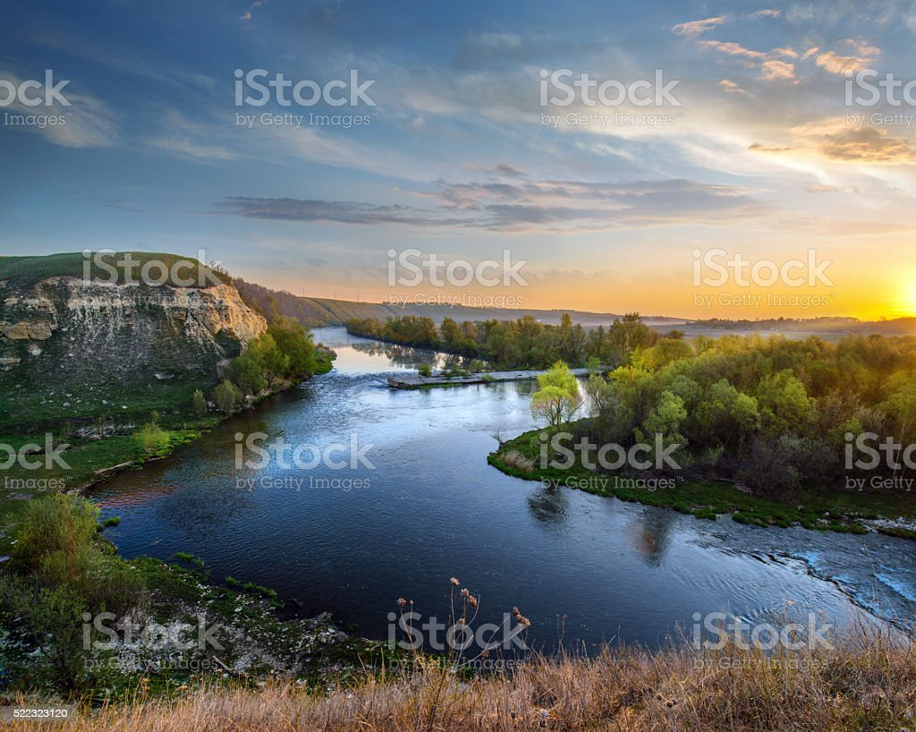 Epic sunrise in river valley stock photo