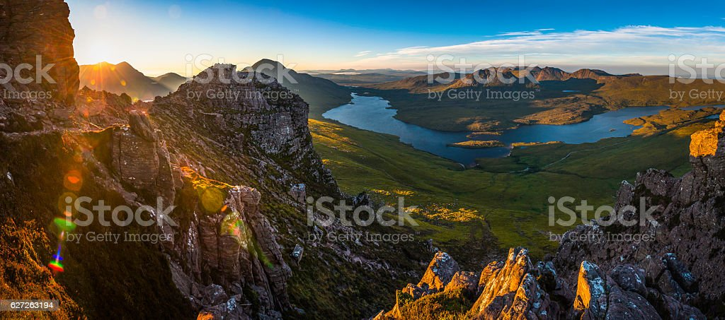 Epic sunrise over Highland peaks glens lochs wilderness panorama Scotland stock photo