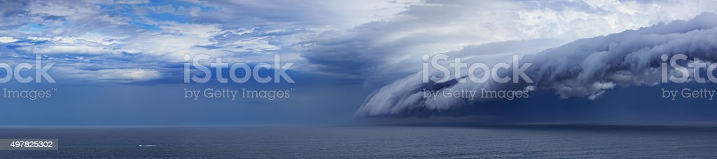 Epic supercell shelf cloud, Small boat feeling, 100megapixel stock photo