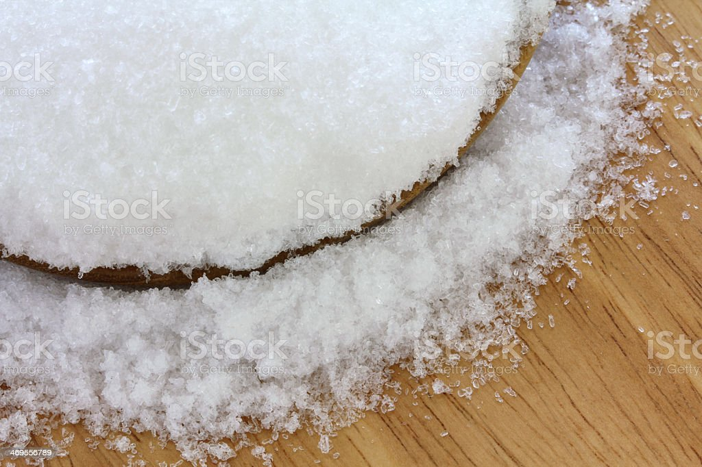 Epsom salts spilling into the floor from a bowl stock photo