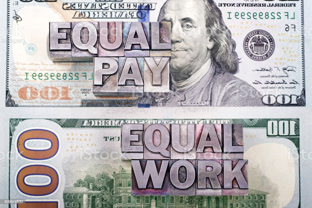equal pay for work stock photo