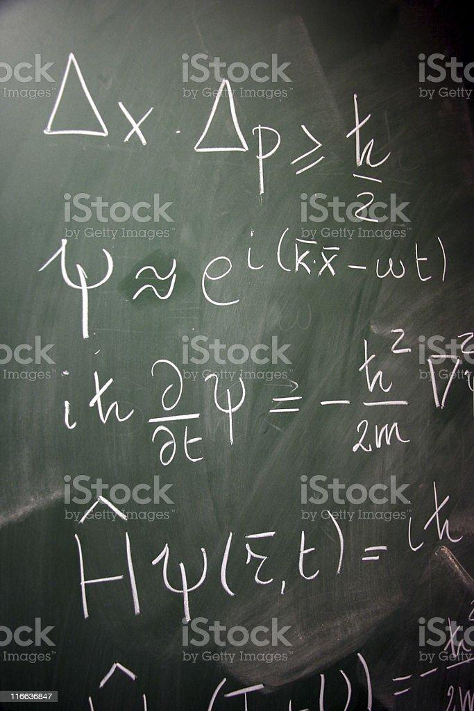 equations on a blackboard stock photo