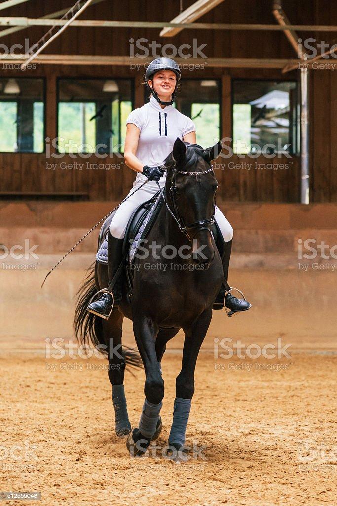 Equestrian Hall Teenage Girl Dressage Riding stock photo