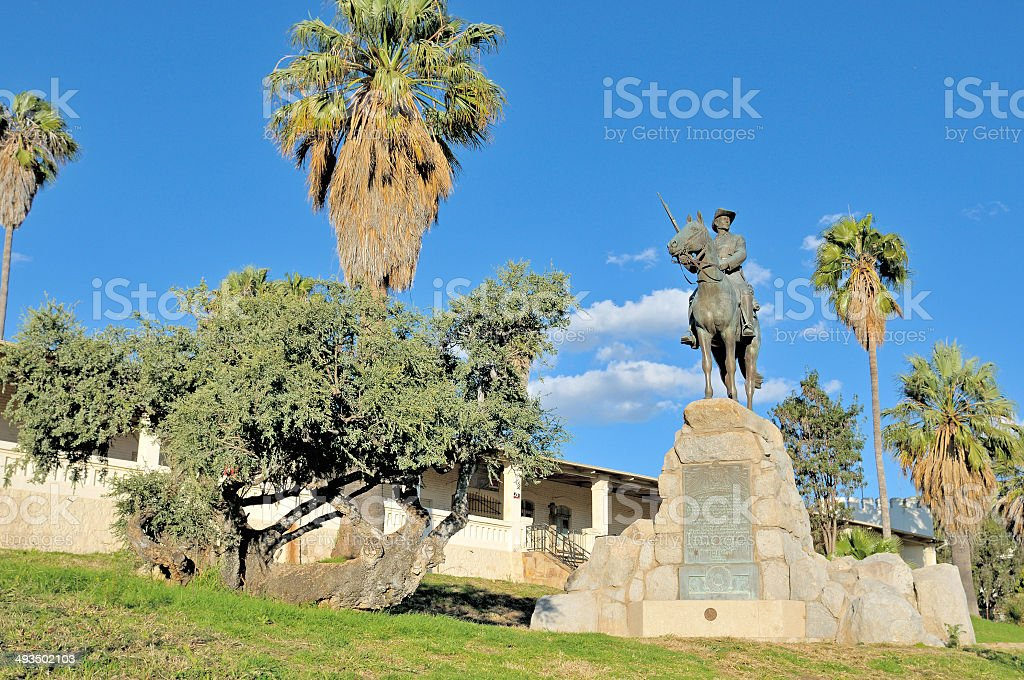 Equestrian rider monument and Alte Feste in Windhoek stock photo