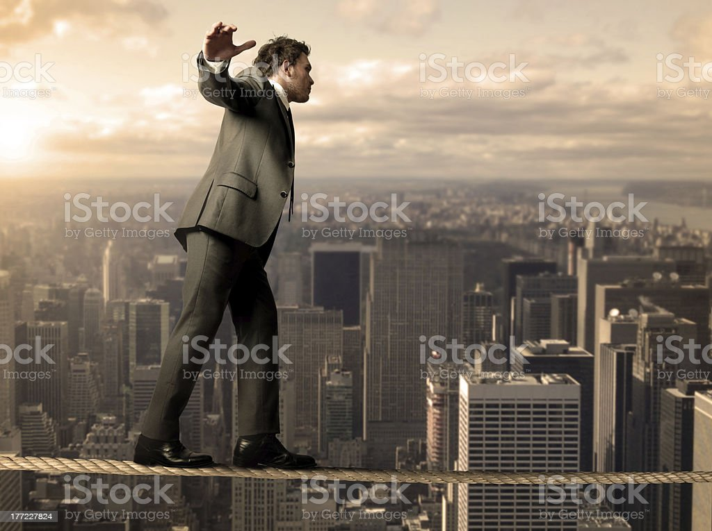 Equilibrist businessman stock photo