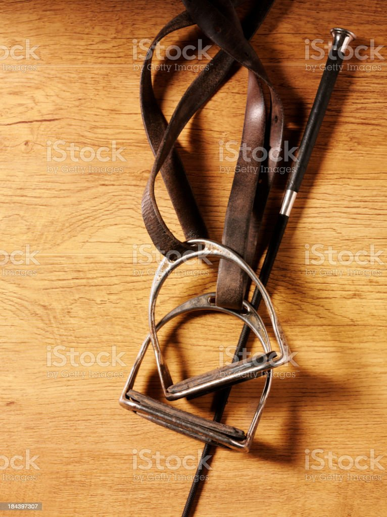 Equine Crop and Stirrups stock photo