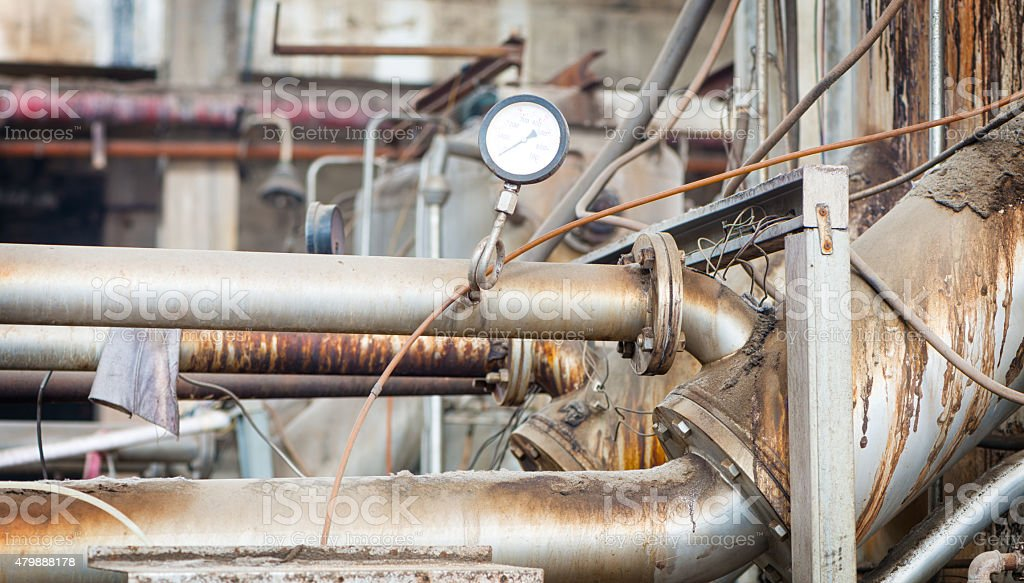 Equipment, cables and piping as found inside of industrial power stock photo