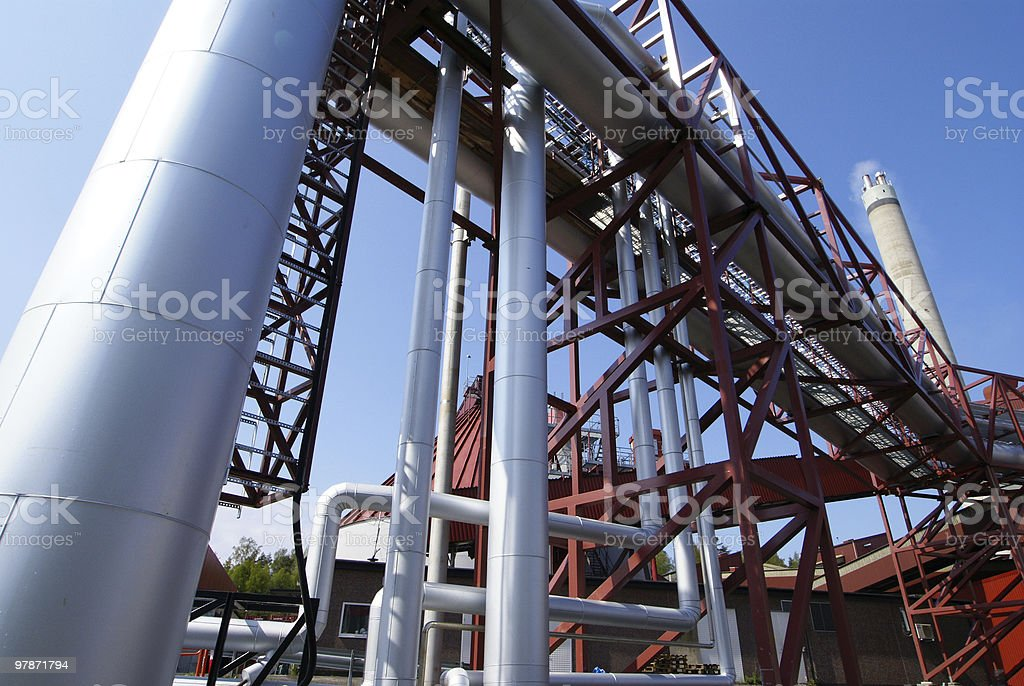 Equipment, cables and smokestack stock photo