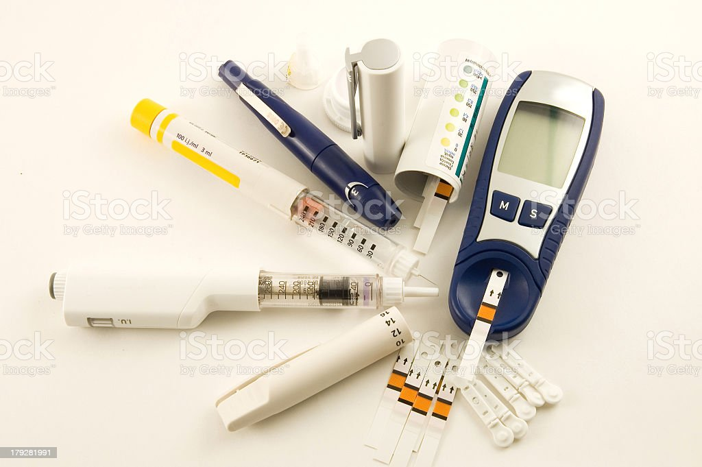 Equipment for monitoring diabetic blood sugar levels stock photo