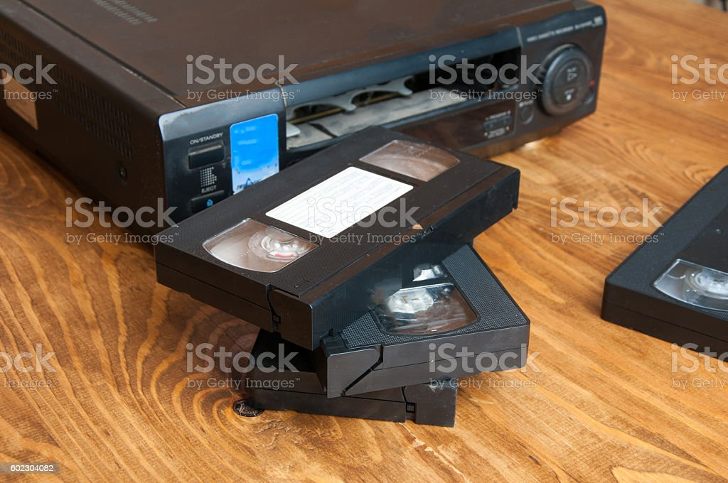Equipment for playing VHS tapes on a wooden table stock photo