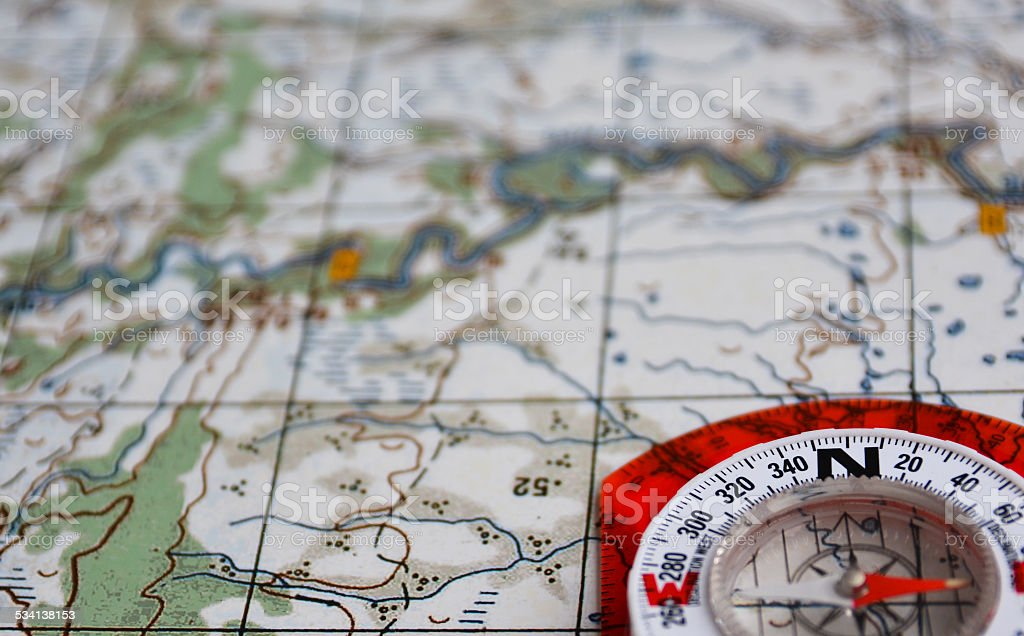 Equipment for travel - map and compass. stock photo