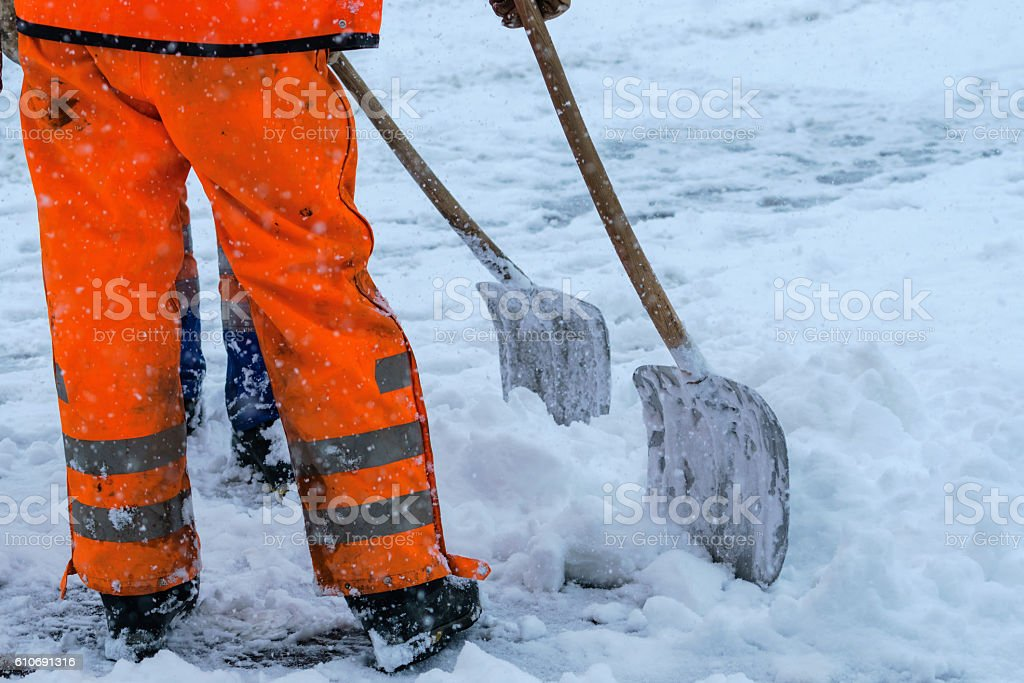 Equipment from worker who sweep snow stock photo