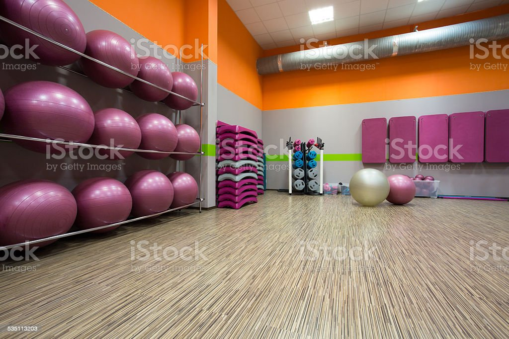 Equipped gym at fitness center stock photo