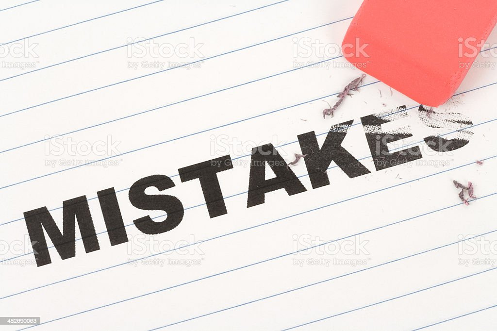 eraser and word mistakes stock photo