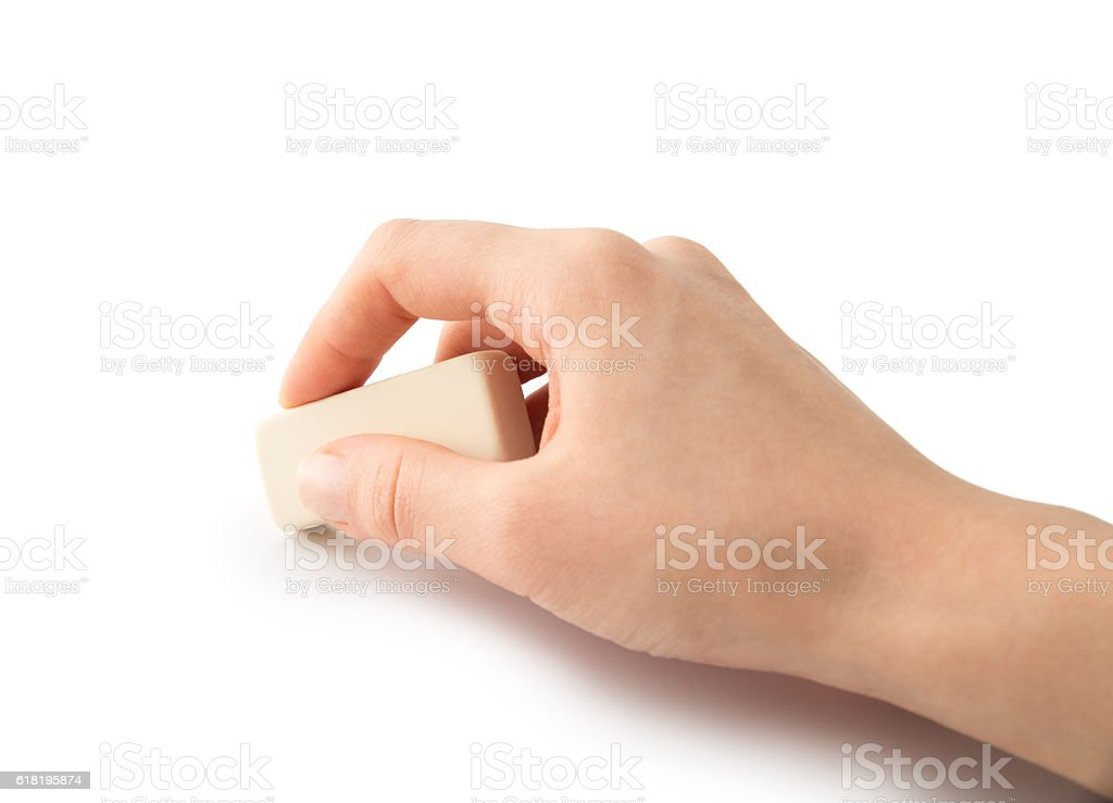 Eraser tool in a hand stock photo