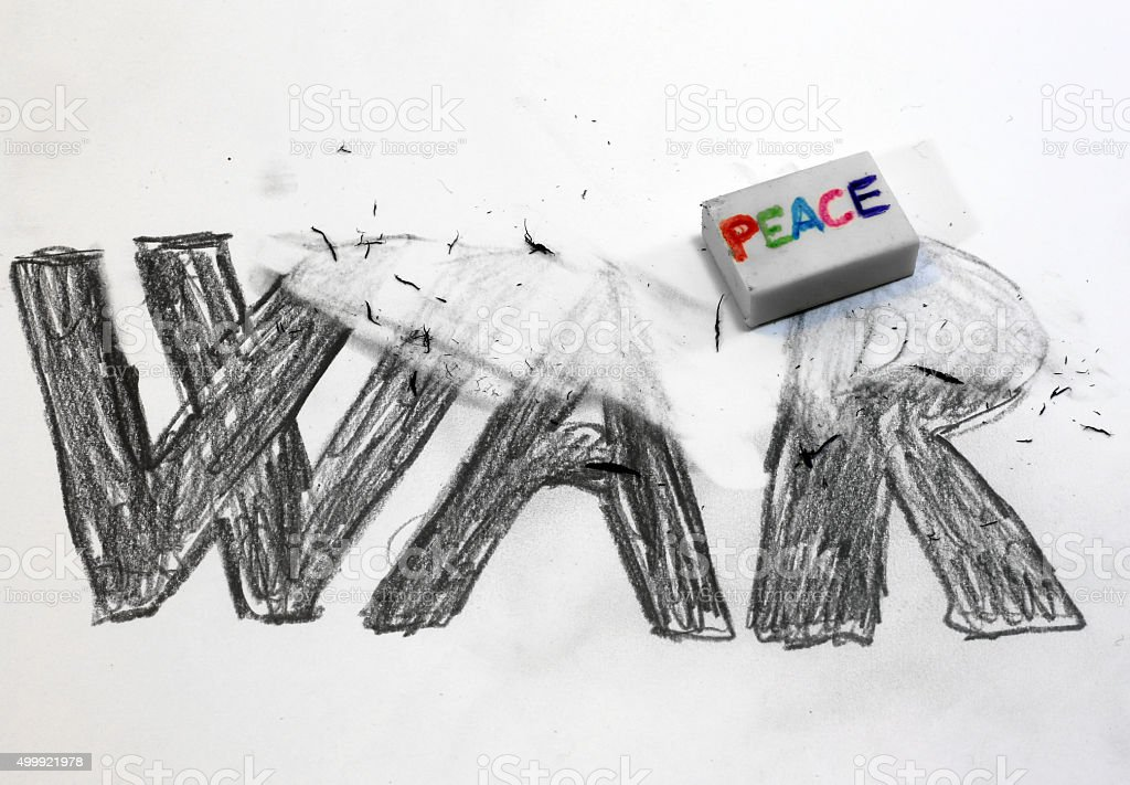 Eraser with written PEACE deletes the written WAR stock photo
