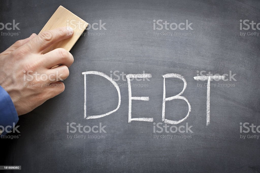 Erasing Debt royalty-free stock photo
