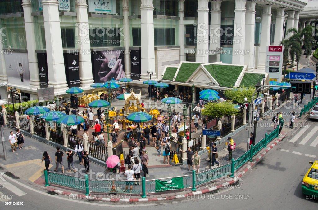 Erawan Shrine and people praying Thao Maha Phrom or Lord Brahma at Ratchaprasong stock photo