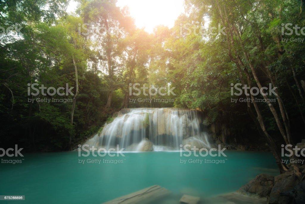 Erawan Waterfall is a beautiful waterfall in spring forest in Kanchanaburi province, Thailand. stock photo