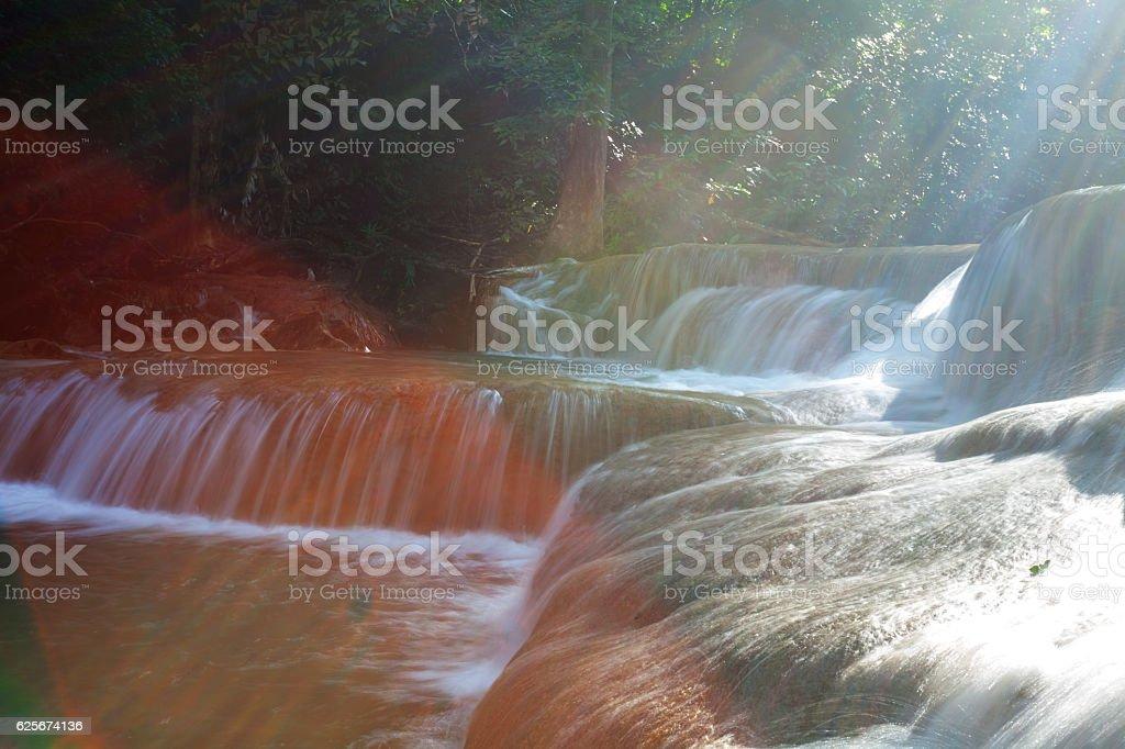 Erawan waterfalls with sunlight effects stock photo