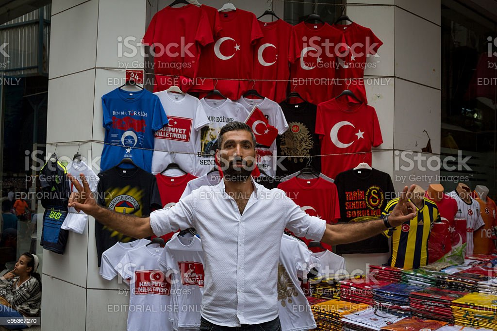 Erdogan supporter in front of pro-Erdogan T-Shirts. stock photo
