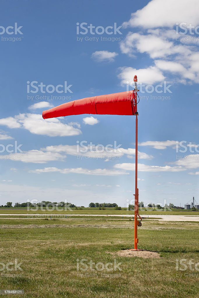 erect orange wind sock stock photo