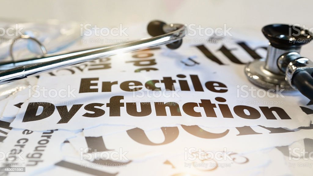 Erectile dysfunction printouts with doctor's stethoscope stock photo