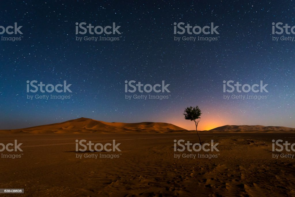 Erg Chebbi in Morocco at night with stars stock photo