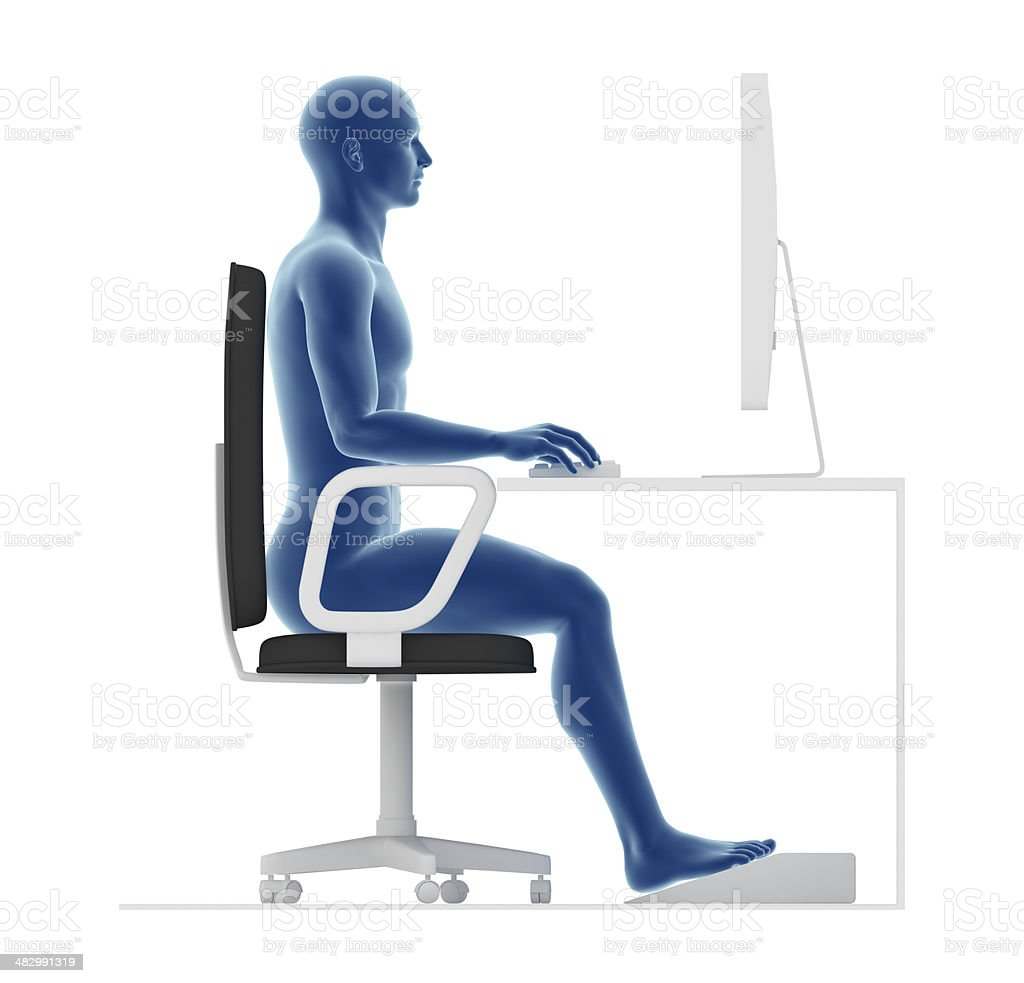 Ergonomics, proper posture to sit and work on office desk stock photo