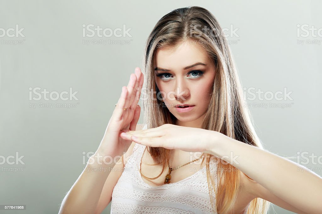 erious woman showing time out stock photo