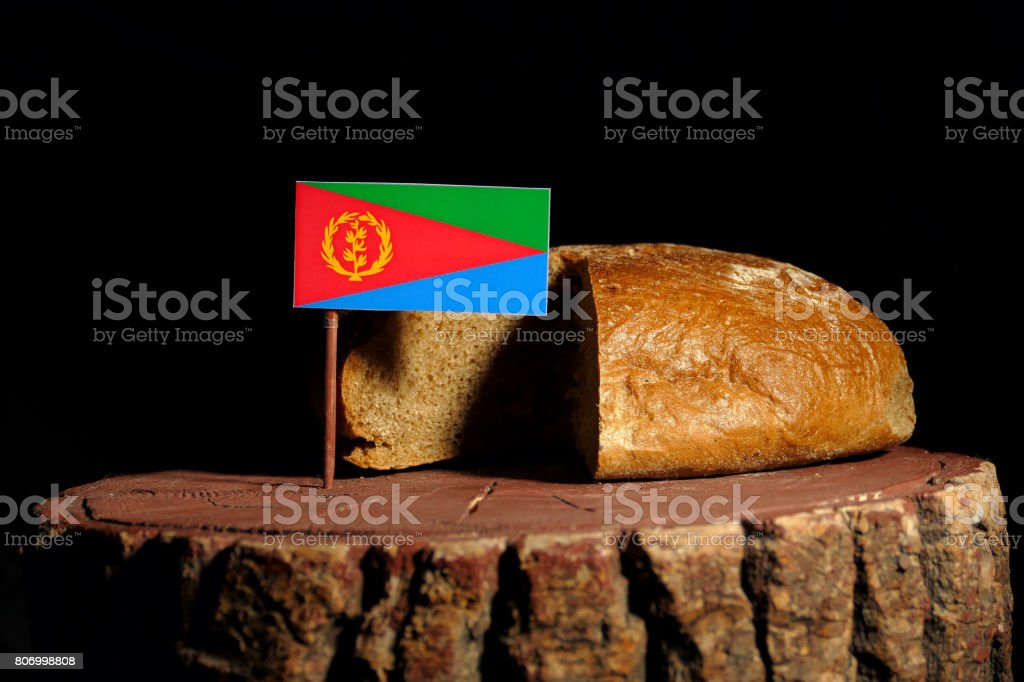 Eritrean flag on a stump with bread isolated stock photo