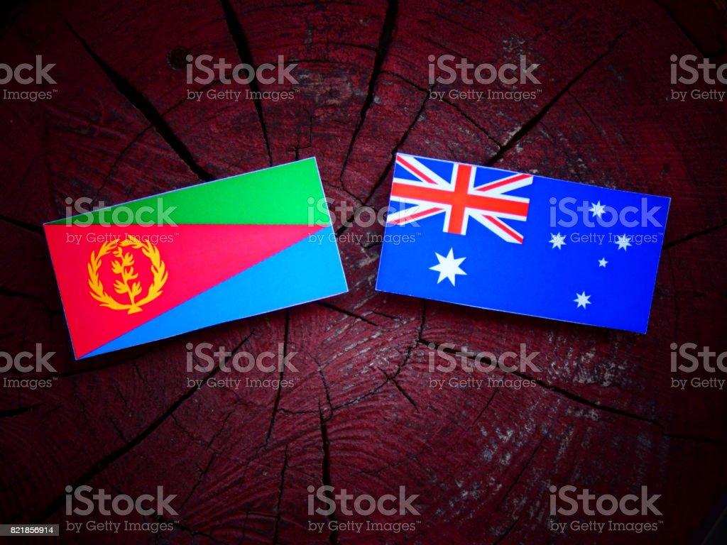 Eritrean flag with Australian flag on a tree stump isolated stock photo